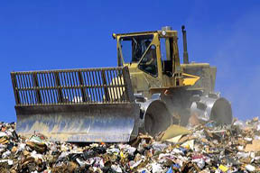 Bulldozer compacter working in a landfill in Boise, Idaho.