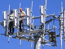 Workers installing a cell phone antenna. telecommunications, communication, telephone, communicate, workers, install, cell phone, antenna, tower, cell, phone, cellular, mobile