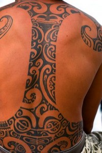 Tahitian man with a tradional tattoo on the island of Moorea.