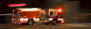 Fire truck in motion at night with lights flashing in Boise, Idaho.