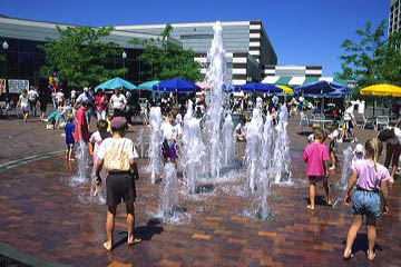 Children play in fountains at the Grove in Boise, Idaho. children, kids, fountains, water, splash, cool, grove, boise, idaho, play