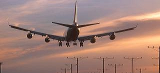 Boeing 747 landing at sunset at LAX airport in Los Angeles, California. airplane, aeroplane, aviation, aircraft, commercial, flying, take off, landing, climb, fly, flying, travel, commerce, transport, transportation, airport, approach