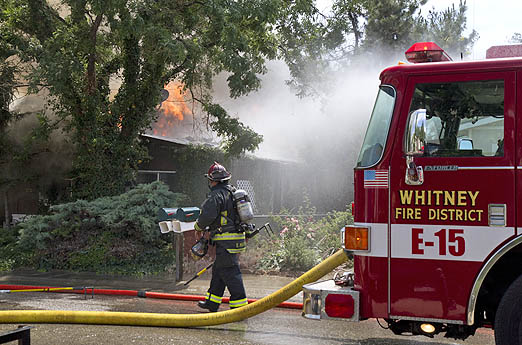 Firefighters battled heat from the sun and the flames Wednesday during a three-alarm blaze east of Boise.