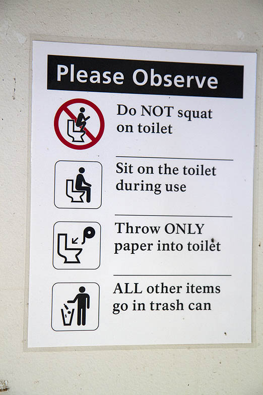 With all the regulations, rules, and suggestions put forth by the United States Government, it was only a matter of time before they told folks how to take a crap! This sign in an outhouse at Yellowstone National Park seems like it came right out of the Donald Trump playbook.  The GUARDIAN got a chuckle reading it and decided it has to be better than most graffiti that otherwise decorates public poopers.