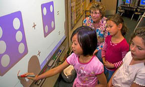 Kindergarten students use an interactive whiteboard in the classroom of a public school in Boise, Idaho, USA. MR