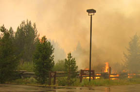 Flames within the Sawtooth Fish Hatchery grounds Monday.