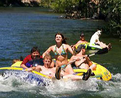 People on inflatable rafts floating the Boise River in Boise, Idaho.