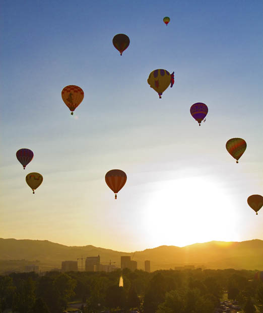 Friday sunrise was meet with balloons over Ann Morrison Park.  Photo copyright DAVID R. FRAZIER