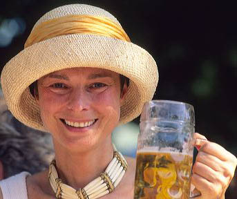 German woman drinking beer. germany, german, europe, european, deutsche, woman, drinking, holding, beer, beverage, alcohol, hat, fashion