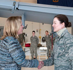 Secretary of the Air Force Deborah Lee James presents a coin to 1st Lt. Heidi Caye, an environmental manager with the 124th Medical Group, for her outstanding performance at Gowen Field, Boise, Idaho, Feb. 19, 2015. (Air National Guard photo by Tech. Sgt. Joshua Allmaras)