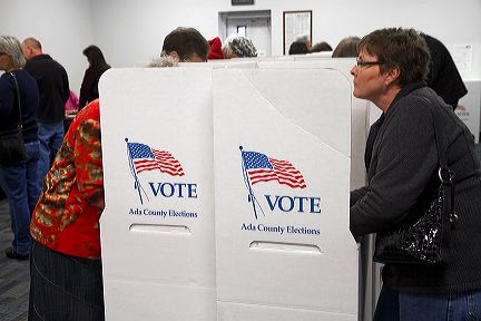 People vote in cardboard voting booths at a polling station in Boise, Idaho, USA.